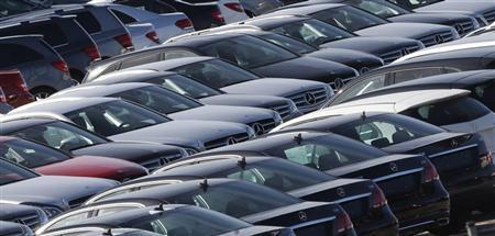 New cars are seen in a carpark near Barcelona, October 23, 2013. REUTERS/Albert Gea