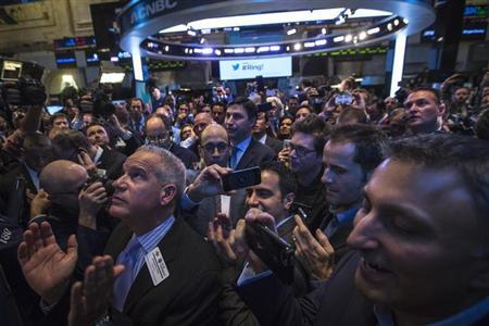 Twitter CEO Dick Costolo takes a photo as Twitter begins to trade during the IPO on the floor of the New York Stock Exchange in New York, November 7, 2013. REUTERS/Brendan McDermid