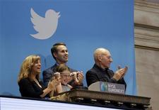 Actor Patrick Stewart (R) and 9-year-old Vivenne Harr (C), who uses proceeds from her lemonade stand to fight slavery, ring the opening bell as NYSE Executive Vice President and Head of Global Listings Scott Cutler and and Boston police officer Cheryl Fiandaca (L) look on during the Twitter Inc. IPO on the floor of the New York Stock Exchange in New York, November 7, 2013. REUTERS/Lucas Jackson