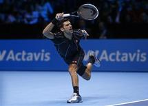 Novak Djokovic of Serbia hits a return during his men's singles tennis match against Juan Martin Del Potro of Argentina at the ATP World Tour Finals at the O2 Arena in London November 7, 2013. REUTERS/Eddie Keogh