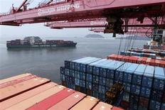 A crane carries a container from a Hanjin Shipping ship at the Hanjin container terminal as a China Shipping Line ship (L) arrives at the Busan New Port in Busan, about 420 km (261 miles) southeast of Seoul, August 8, 2013. REUTERS/Lee Jae-Won