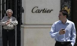 Two men stand outside the Cartier store on Rodeo Drive in Beverly Hills, California, May 21, 2013. REUTERS/Fred Prouser