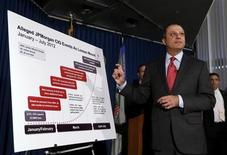 U.S. Attorney for the Southern District of New York Preet Bharara points to a chart during a news conference announcing the unsealing of charges against two derivative traders Javier Martin-Artajo and Julien Grout in New York August 14, 2013. REUTERS/Shannon Stapleton