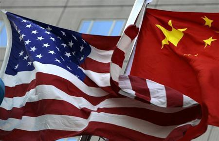 National flags of U.S. and China wave in front of an international hotel in Beijing February 4, 2010. REUTERS/Jason Lee