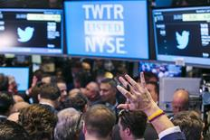 A trader raises his hand just before the Twitter Inc. IPO begins on the floor of the New York Stock Exchange in New York, November 7, 2013. REUTERS/Lucas Jackson