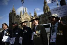 Retired Gurkha soldiers march in protest during a demonstration outside the Palace of Westminster in London October 25, 2013. REUTERS/Dylan Martinez