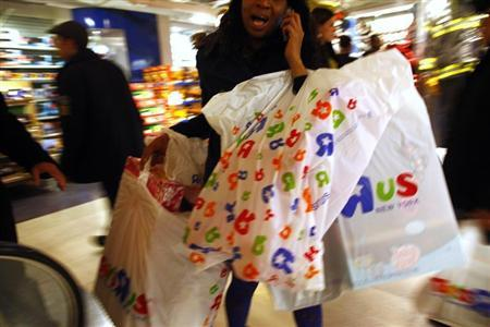 Customers shop at Toys R Us in New York November 24, 2011. REUTERS/Eric Thayer