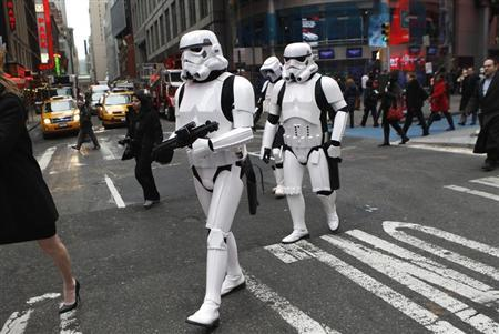 Star Wars Storm Trooper characters cross the street outside the NASDAQ Market Site in New York's Times Square after taking part in ringing the opening bell for the trading day, December 20, 2011. REUTERS/Mike Segar