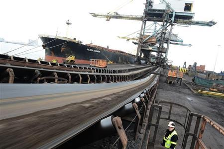 Iron Ore from Brazil is delivered to SSI steel plant at Redcar, northern England May 29, 2012. REUTERS/Nigel Roddis