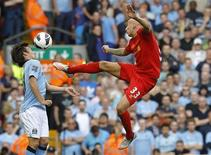 Liverpool's Jonjo Shelvey (R) is challenged by Manchester City's David Silva during their English Premier League soccer match at Anfield in Liverpool, northern England, August 26, 2012. REUTERS/Phil Noble