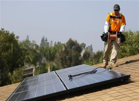 Vivint Solar Technician Eduardo Aguilar Lays A Copper Line While Installing Panels On The Roof Of House In Mission Viejo California