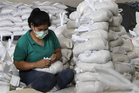 A volunteer packs rice inside a Department of Social Welfare and Development warehouse before shipping them out to the devastated provinces hit by Typhoon Haiyan in Manila November 8, 2013. REUTERS/Romeo Ranoco