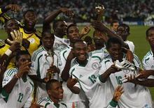 Nigeria's team players celebrate winning their U-17 World Cup UAE final soccer match against Mexico at Mohammed Bin Zayed Stadium in Abu Dhabi November 8, 2013. REUTERS/Ahmed Jadallah