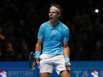 Rafael Nadal of Spain celebrates winning his match against Tomas Berdych of the Czech Republic during their men's singles tennis match at the ATP World Tour Finals at the O2 Arena in London November 8, 2013. REUTERS/Eddie Keogh