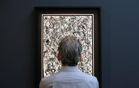 A visitor views American painter Jackson Pollock's 'Number 19,' oil and enamel on paper laid down on canvas, 1948 and estimated between $25-35 million, during a preview of Christie's Post-War and Contemporary Evening sale at Christie's auction house in New York, May 3, 2013. REUTERS/Mike Segar