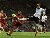 Liverpool's Daniel Sturridge (L) challenges Fulham's Dimitar Berbatov during their English Premier League soccer match at Anfield in Liverpool, northern England November 9, 2013. REUTERS/Phil Noble