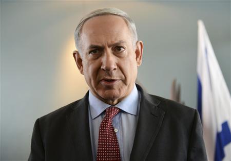 Israeli Prime Minister Benjamin Netanyahu delivers a statement to the media after meeting U.S. Secretary of State John Kerry at Ben Gurion Airport near Tel Aviv November 8, 2013. REUTERS/Debbie Hill/Pool