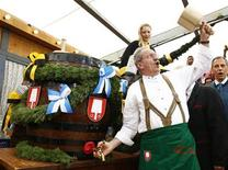 Munich Mayor Christian Ude taps the first barrel of beer during the opening ceremony for the 180th Oktoberfest in Munich September 21, 2013. REUTERS/Michaela Rehle