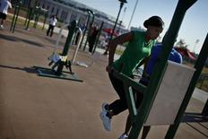 A woman works out in an outdoor exercise area at Macombs Dam Park in the Bronx section of New York City, September 13, 2012. REUTERS/Mike Segar