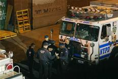 New York Police Department Officers depart a multiple shooting crime scene on Maujer Street in the Brooklyn borough of New York, November 11, 2013. REUTERS/Lucas Jackson
