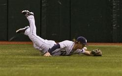 Tampa Bay Rays right fielder Wil Myers comes up short as he dives for Texas Rangers' Elvis Andrus' single during the first inning of their MLB American League baseball game in St. Petersburg, Florida, September 18, 2013. REUTERS/Steve Nesius
