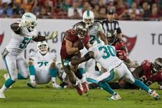 Nov 11, 2013; Tampa, FL, USA; Miami Dolphins strong safety Chris Clemons (30) defends Tampa Bay Buccaneers running back Brian Leonard (30) during the second half of the game at Raymond James Stadium. Mandatory Credit: Rob Foldy-USA TODAY Sports