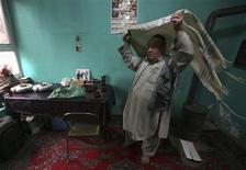 Zabulon Simintov, an Afghan Jew, prepares for prayers at his residence in Kabul November 5, 2013. REUTERS/Omar Sobhani