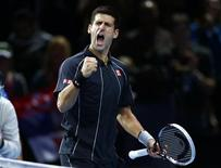 Novak Djokovic of Serbia celebrates winning his men's singles tennis match against Richard Gasquet of France at the ATP World Tour Finals at the O2 Arena in London November 9, 2013. REUTERS/Eddie Keogh