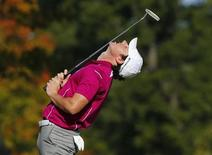 Team Europe golfer Rory McIlroy of Northern Ireland bends backwards as he misses a birdie putt to halve the seventh hole during the morning foursomes round at the 39th Ryder Cup golf matches at the Medinah Country Club in Medinah, Illinois September 29, 2012. REUTERS/Mike Blake