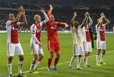 Ajax Amsterdam's players celebrate their victory against Celtic after their Champions League soccer match at Amsterdam Arena November 6, 2013. REUTERS/Toussaint Kluiters