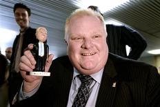 Toronto Mayor Rob Ford shows off his bobblehead doll at City Hall in Toronto November 12, 2013. REUTERS/Aaron Harris