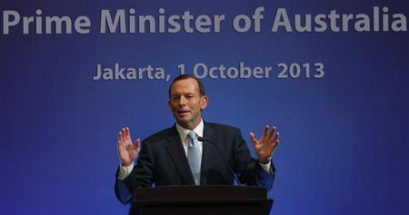 Australia's Prime Minister Tony Abbott speaks at a breakfast meeting in Jakarta October 1, 2013. Abbott is on a two-day visit to Indonesia file photo. REUTERS/Supri