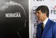 "Director Alexander Payne poses next to the poster for his film as he arrives for a gala screening of his new film ""Nebraska"" at the AFI Fest 2013 in Hollywood November 11, 2013. REUTERS/Fred Prouser"