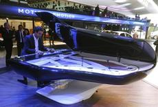A musicien plays on a piano made by Peugeot Design Lab and Pleyel on media day at the Paris Mondial de l'Automobile September 27, 2012. REUTERS/Jacky Naegelen
