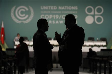 Delegates talk during a break in a plenary session on the second day of the 19th conference of the United Nations Framework Convention on Climate Change (COP19) at the National Stadium in Warsaw November 12, 2013. REUTERS/Kacper Pempel