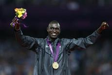 Gold medallist David Lekuta Rudisha of Kenya celebrates during the presentation ceremony for the men's 800m event at the London 2012 Olympic Games at the Olympic Stadium August 9, 2012. REUTERS/Eddie Keogh