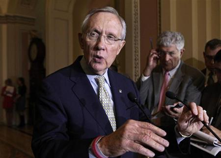 U.S. Senate Majority Leader Harry Reid (D-NV) (L) speaks to the media about healthcare on Capitol Hill in Washington October 29, 2013. REUTERS/Yuri Gripas