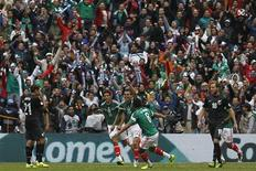 Mexico's Paul Aguilar (C) celebrates his goal with Raul Jimenez (L) and Juan Medina during their 2014 World Cup qualifying playoff first leg soccer match against New Zealand at Azteca stadium in Mexico City November 13, 2013. REUTERS/Edgard Garrido