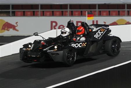 Driver Michael Schumacher (R) drives during the Race of Champions (ROC) Nations Cup at Rajamangala National Stadium in Bangkok December 15, 2012. REUTERS/Chaiwat Subprasom