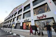 People walk past clothing shops at Venice Street in Benghazi November 7, 2013. REUTERS/Esam Omran Al-Fetori
