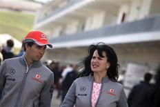 McLaren Formula One driver Sergio Perez (L) of Mexico arrives to the track at the Circuit of The Americas in Austin, Texas November 14, 2013. REUTERS/Adrees Latif