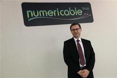 Eric Denoyer, PDG de Numericable. Le principal opérateur du câble en France a levé au total 749,1 millions d'euros dans le cadre de son introduction en Bourse à la suite de l'exercice d'une option de surallocation prévue dans le cadre de l'opération. /Photo prise le 28 octobre 2013/REUTERS/Christian Hartmann