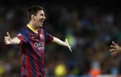 Barcelona's Lionel Messi celebrates scoring a goal against Ajax during their Champions League soccer match at Camp Nou stadium in Barcelona September 18, 2013. REUTERS/Albert Gea