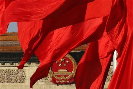 The Great Hall of the People, where the Chinese Communist Party plenum is being held, is seen behinds red flags in Tiananmen square in Beijing November 12, 2013. REUTERS/Kim Kyung-Hoon