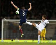 Scotland's Scott Brown (L) is tackled by Jermaine Jones of the U.S. during their international friendly soccer match at Hampden Park Stadium in Glasgow, Scotland, November 15, 2013. REUTERS/Russell Cheyne