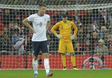 England's goalkeeper Fraser Forster looks down after a goal by Chile's Alexis Sanchez during their international friendly soccer match at Wembley Stadium in London November 15, 2013. REUTERS/Toby Melville