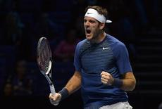 Juan Martin del Potro of Argentina celebrates after defeating Richard Gasquet of France during their ATP World Tour Finals tennis match at the O2 Arena in London, November 4, 2013. REUTERS/Toby Melville