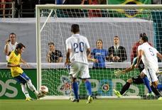 Nov 16, 2013; Miami Gardens, FL, USA; Brazil forward Bernard (20) scores a goal against Honduras during the first half at Sun Life Stadium. Mandatory Credit: Joe Camporeale-USA TODAY Sports