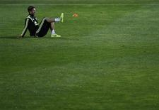 Spain national player Sergio Ramos takes part in a soccer training session at Soccer City in Las Rozas, near Madrid, November 13, 2013. REUTERS/Susana Vera