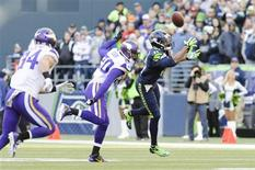 Nov 17, 2013; Seattle, WA, USA; Seattle Seahawks wide receiver Percy Harvin (11) catches a pass over Minnesota Vikings cornerback Chris Cook (20) during the first half at CenturyLink Field. Mandatory Credit: Steven Bisig-USA TODAY Sports